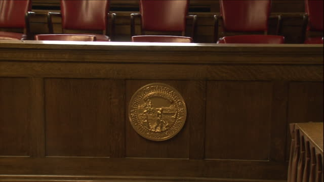 a seal adorns the judge's box in a supreme court. - justice concept stock videos & royalty-free footage