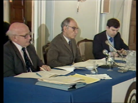 stockvideo's en b-roll-footage met london connaught rooms tbv people seated at royal commission hearing zoom in to commissioners on platform tms man giving evidence at inquiry ms... - yeomen warder