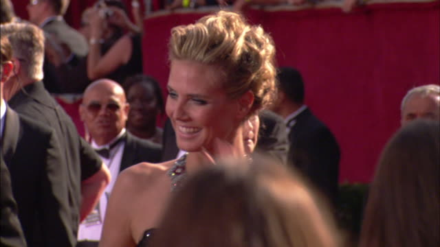 seal & heidi klum walking down the red carpet holding hands and waving at nokia theater - emmy awards stock videos & royalty-free footage
