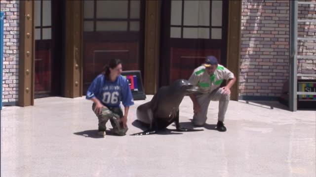 A seal mimics its trainers.