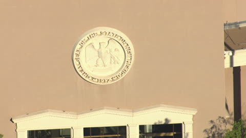 cu aerial zo seal of state of new mexico on roundhouse - puebloan culture stock videos & royalty-free footage