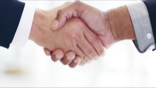 sealing the deal with a handshake - new hire stock videos & royalty-free footage