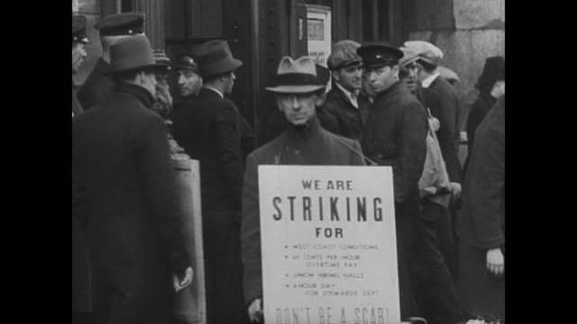 seamen on strike walking w/ pickets sign welcoming ss roosevelt crew mounted police watching strikers walking together - streikposten stock-videos und b-roll-filmmaterial