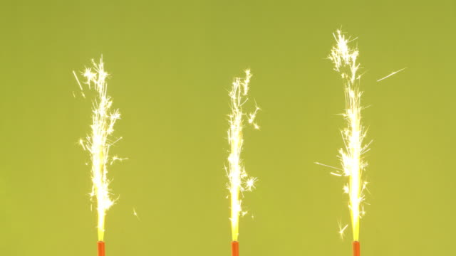 seamless loop tart sparklers - three objects stock videos & royalty-free footage