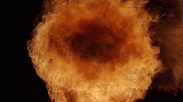 seamless looping image of a circular explosion of fire. - fireball stock videos & royalty-free footage