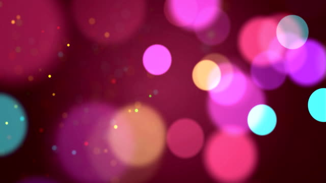 vídeos de stock e filmes b-roll de seamless multi-colored particles bokeh abstract, 4k video loop - plano de fundo