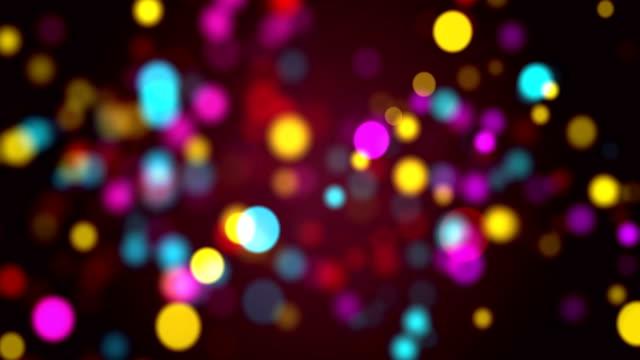 vídeos y material grabado en eventos de stock de partículas multicolores sin costuras bokeh abstract, bucle de vídeo 4k - gala