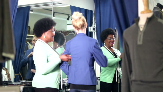 seamstress helping customer with clothing alterations - 50 59 years stock videos & royalty-free footage