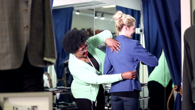 seamstress helping customer with clothing alterations - waist stock videos & royalty-free footage