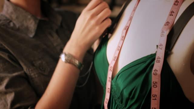 CU TD Seamstress hemming dress / New York City, New York, USA