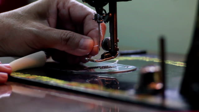 seamstress threading a sewing machine - needle plant part stock videos and b-roll footage