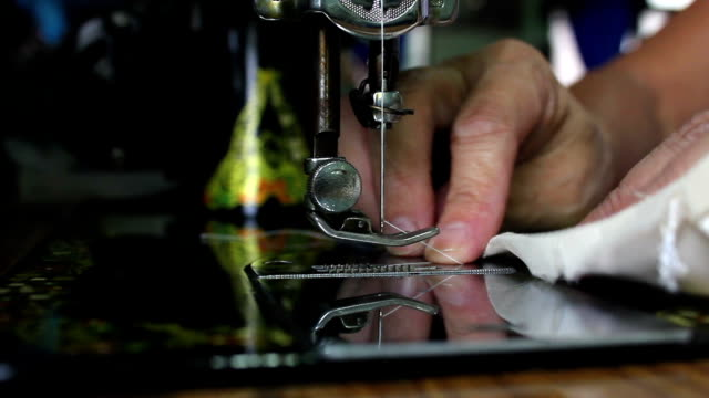 seamstress working on sewing machine - needle plant part stock videos & royalty-free footage