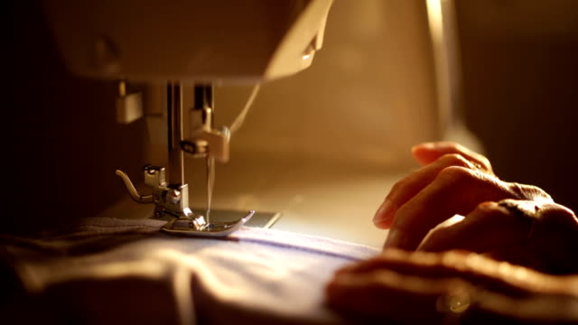 seamstress working with sewing machine - sewing machine stock videos & royalty-free footage