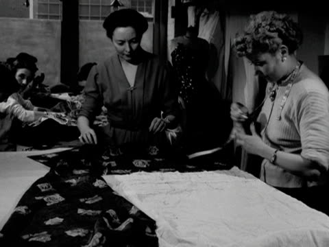 vídeos y material grabado en eventos de stock de seamstresses work at the hartnell workshop 1953 - cinta métrica