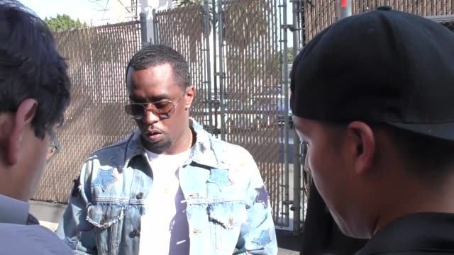 vídeos de stock e filmes b-roll de interview sean combs talks about the manchester attack while he greets fans outside jimmy kimmel live in hollywood in celebrity sightings in los... - sean combs