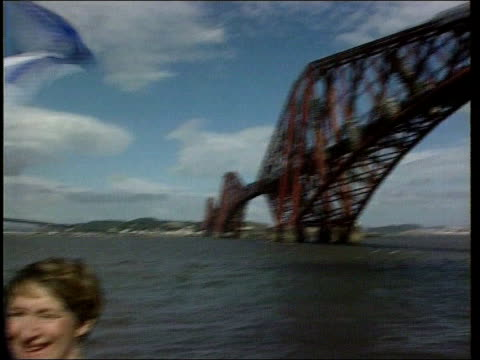 sean connery knighthood row; lib firth of forth:gv forth bridge to sean connery standing on boat next gordon brown mp as st andrew's flag flies... - sean connery stock videos & royalty-free footage