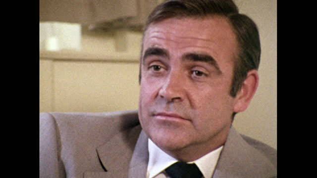 stockvideo's en b-roll-footage met sean connery, speaking in 1971, on his work outside of acting that includes the scottish international education trust, banking, communications and a... - 40 seconds or greater