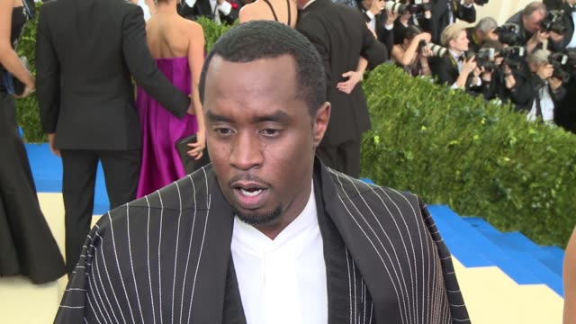 vídeos de stock, filmes e b-roll de interview sean diddy combs on his attire and enjoying the evening at rei kawakubo/comme des garcons art of the inbetween costume institute gala... - sean combs