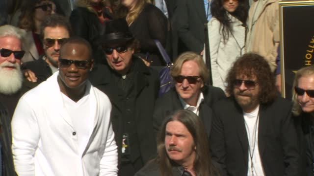 sean garrett eric idle and t bone burnett at the roy orbison honored posthumously with a star on the hollywood walk of fame at hollywood ca - eric idle stock-videos und b-roll-filmmaterial