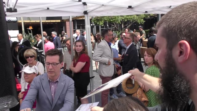 sean hayes signs for fans at eric mccormack's star ceremony on the hollywood walk of fame in hollywood in celebrity sightings in los angeles, - eric mccormack stock videos & royalty-free footage