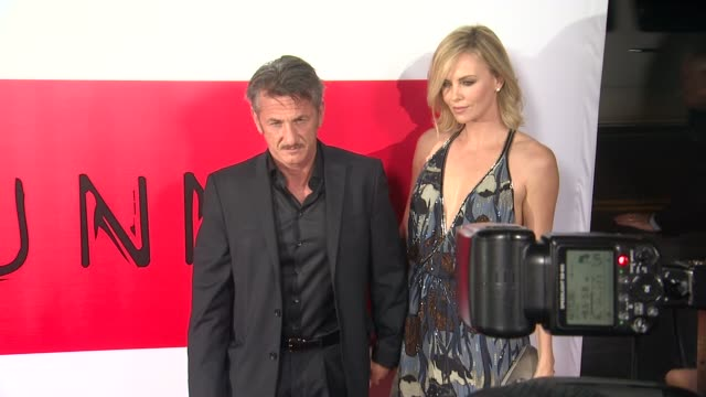 Sean Penn and Charlize Theron at the The Gunman Los Angeles Premiere at Premiere House on March 12 2015 in Los Angeles California