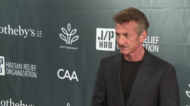 vídeos y material grabado en eventos de stock de chyron – sean penn friends haiti takes root benefit dinner auction supporting j/p haitian relief organization at sotheby's on may 05 2017 in new york... - sean penn