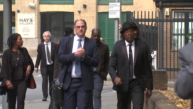 court arrivals england london southwark crown court ext people along into court for sergeant paul white trial - サウスワーク刑事法院点の映像素材/bロール