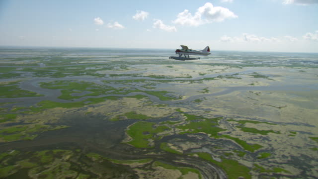 AERIAL WS Seaplane flying over delta gulf / New Orleans, Louisiana, United States