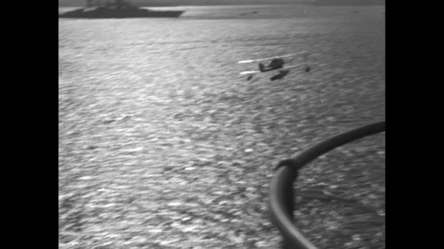 seaplane on rotating catapult on bow of ship / plane shoots off catapult and flies across water / slow motion shot of seaplane shooting off catapult... - ship's bow stock videos & royalty-free footage
