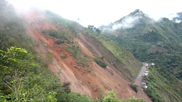 Search and rescue efforts for as many as 30 people who were buried a day ago in a landslide on a highway in northwestern Colombia was suspended late...