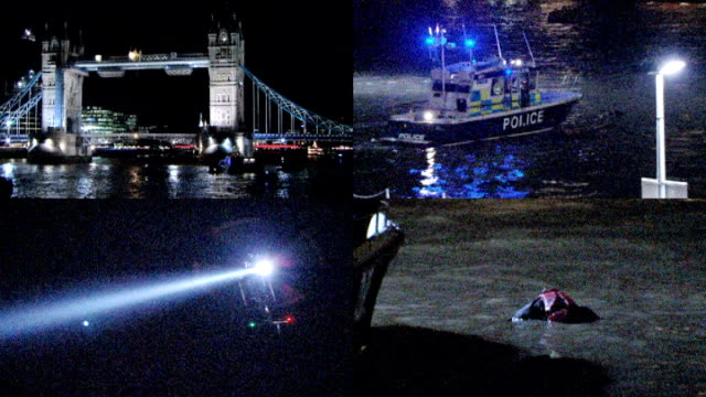 Search and rescue training on Thames ENGLAND London Tower Bridge / Police river boat along / Police helicopter hovering / Model representing casualty...