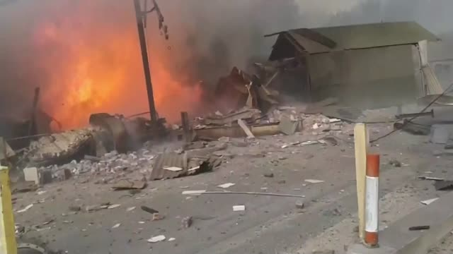 search continues for missing people following cheshire mill explosin t17071502 / tx video shaky shots showing debris wreckage and burning buildings... - flour mill stock videos & royalty-free footage