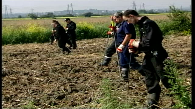 Search continues for missing teenager Danielle Jones ITN Essex Tilbury Policeman looking at bag of rubbish police search team walking across field /...