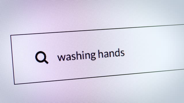"""search engine about coronavirus. typing """"washing hands"""" in the search bar. - hygiene stock videos & royalty-free footage"""