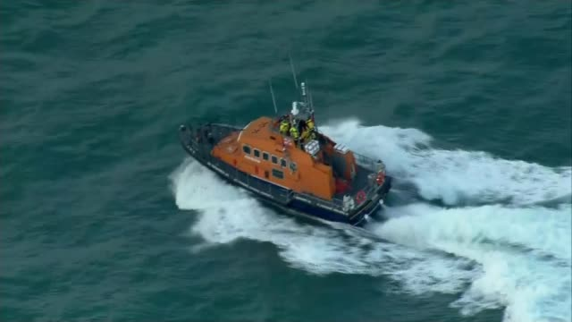 search set to resume for plane of missing footballer emiliano sala; guernsey: ext air views coastguards' boat along at sea searching for the plane of... - guernsey stock videos & royalty-free footage