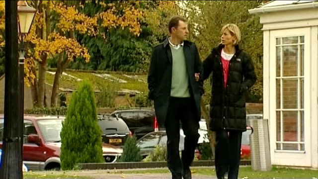 search underway for parents of 4-year-old girl rescued from roma settlement; file / date unknown: england: ext gerry mccann and kate mccann walking... - gerry mccann stock-videos und b-roll-filmmaterial