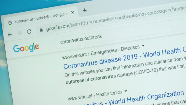 searching for coronavirus on google search engine. - searching stock-videos und b-roll-filmmaterial