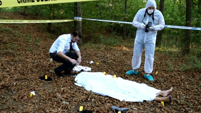 Searching for evidence on murder scene