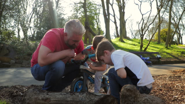 Searching for Worms in the Park with their Father