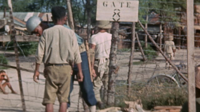 mp searching japanese prisoners as they enter pow camp / saipan mariana islands - saipan stock videos and b-roll footage