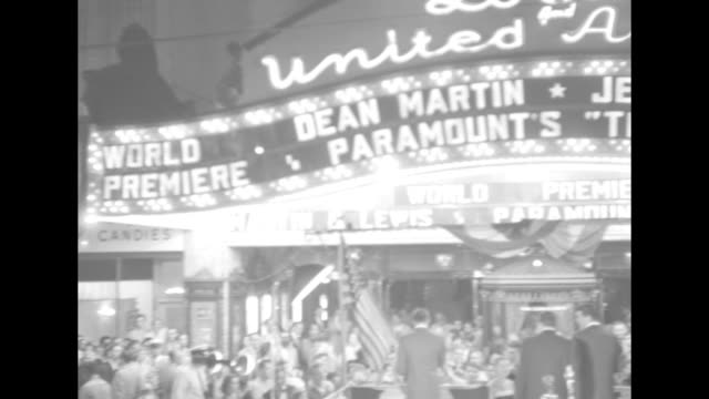 "searchlight sweeps exterior of lowe's ohio theater / lighted marquee ""dean martin, jerry lewis, paramount's 'the caddy', world premiere..'"" and... - comedian stock videos & royalty-free footage"