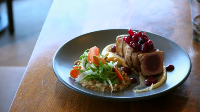PAN CU Seared Ahi with local vegetables farro and cranberry sauce