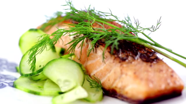 Seared Salmon Filet Garnished with Dill and Lemon