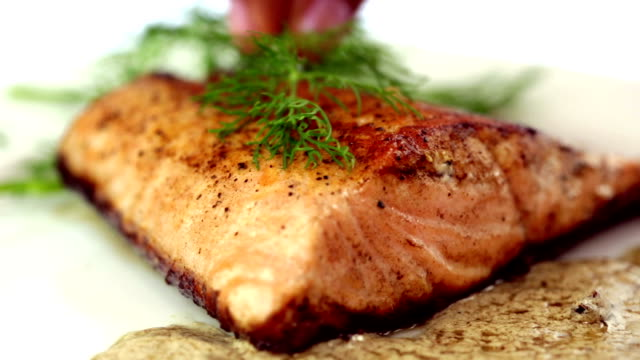 Seared Salmon Filet Garnished with Dill