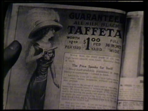sears catalog pages, including taffeta, winter weight underwear, men's suits . mail order - anno 1910 video stock e b–roll