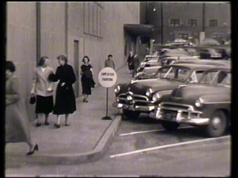 sears department store, various employees walking through parking lot, car pulling into 'employee parking' spot, workers entering through doorway... - department store stock videos & royalty-free footage