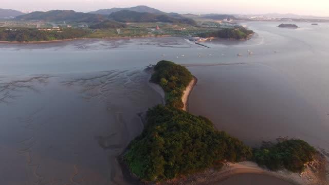 Seascape and Mud flat of Yedanpo dock in Yeongjong-do island at sunset