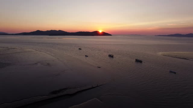 Seascape and Mud flat of Yedanpo dock in Yeongjong-do island at sunset