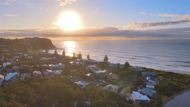 seascape and village around avoca beach in central coast at sunrise / new south wales, australia - wide stock-videos und b-roll-filmmaterial