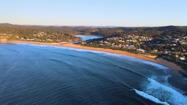 seascape and village around avoca beach in central coast / new south wales, australia - costa caratteristica costiera video stock e b–roll